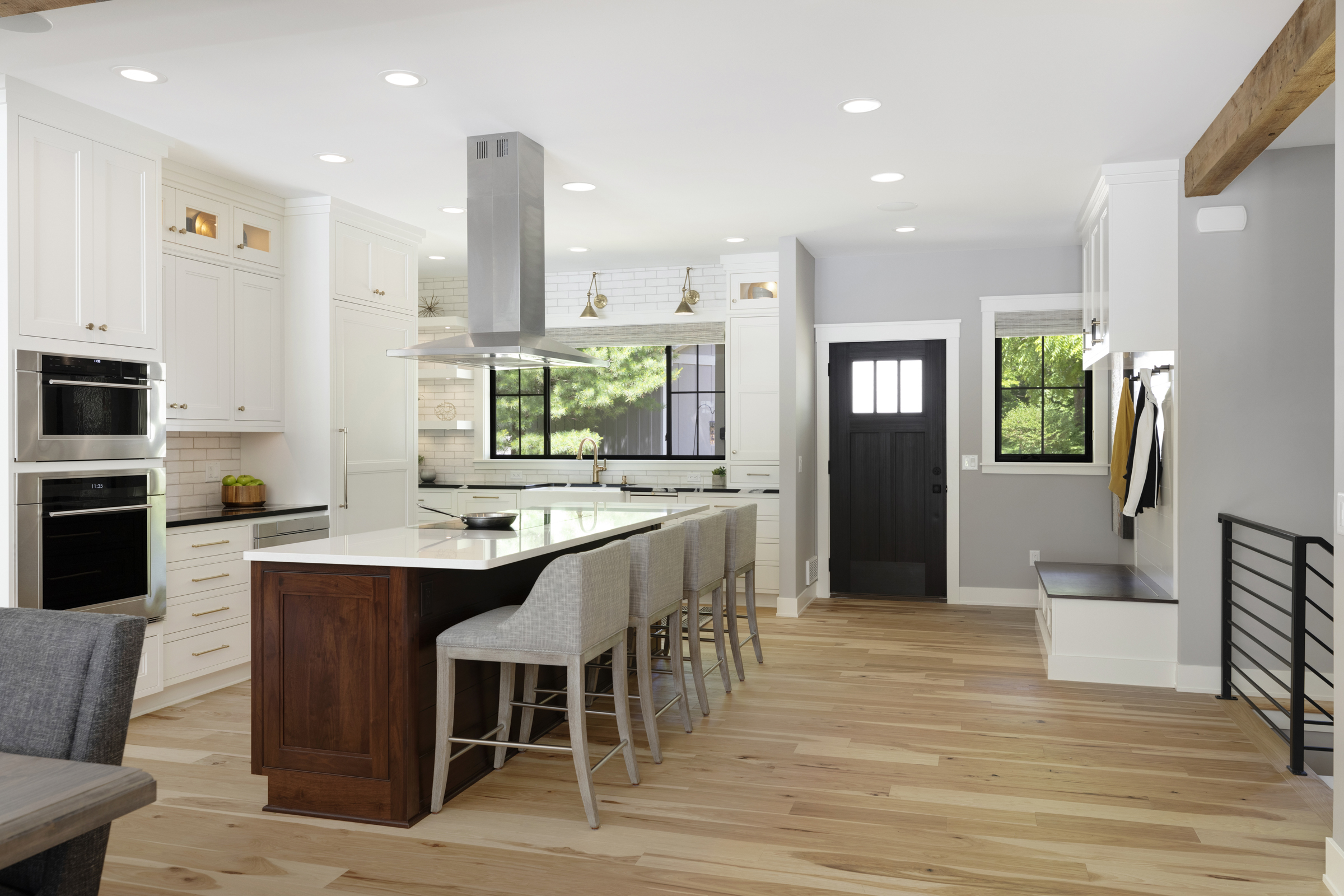 Large open kitchen with warm wood island and large windows. | Crystal Kitchen and Bathroom Remodelers